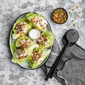 a photo of an iceberg salad recipe topped with carman's seed mix