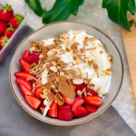 a photo of a yoghurt bowl recipe with carman's goodness & grains cereal on top
