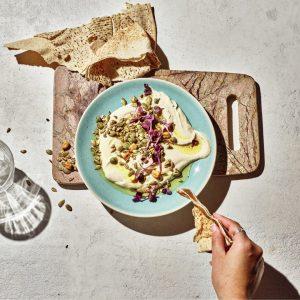 a photo of a hummus recipe with carman's chilli corn crunch super seeds
