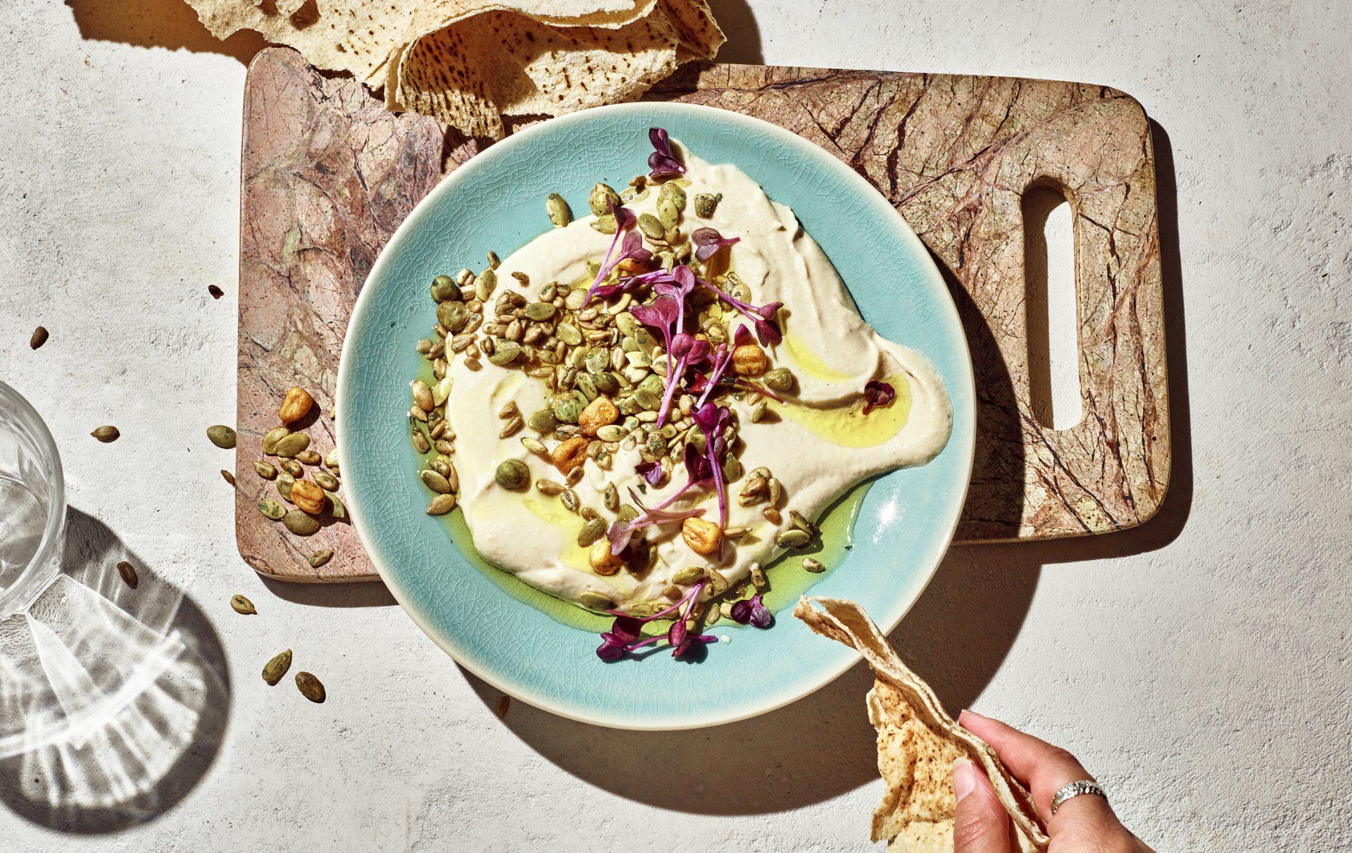 a photo of a hummus recipe with carman's chilli corn crunch